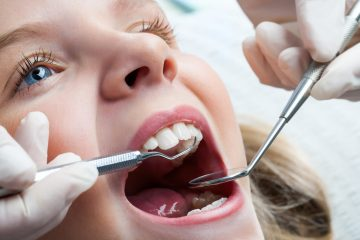 Young Girl At Dentist.
